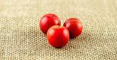 Macro of three ball shaped cherry plums