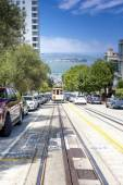 San-Francisco-United States, July 13, 2014: Authentic San-Francisco Tram Ascending Uphill With People on July 13, 2014 in San-Francisco