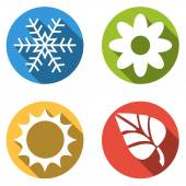 Set of 4 isolated flat colorful buttons for 4 seasons icons - snowflake for winter flower for spring sun for summer and leaf for autumn