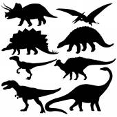 Vector set of 8 dinosaurs silhouettes on white background