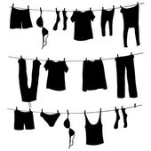 Vector Silhouettes of Laundry on a Rope on white background