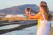 Tourists taking photo at salt marsh