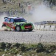 Постер, плакат: :Ukranian driver Valeriy Gorban and co driver Volodymyr Korsia steer their BMW Mini John Cooper Works