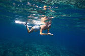 Young women is snorkeling