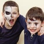 Постер, плакат: Zombie apocalypse kids concept Birthday party celebration facepaint on children dead bride scar face skeleton together