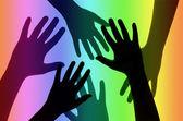 Silueta rukou na pozadí Rainbow
