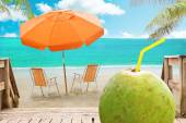 Chaise lounge, coconut and umbrella on beach