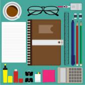 Top view of modern business items and office items on green desk