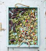Okra, spicy peppers and small black corns