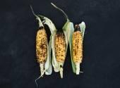 Grilled corns over black  slate