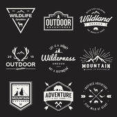 Vector set of wilderness and nature exploration vintage  logos emblems silhouettes and design elements outdoor activity symbols with grunge textures