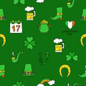 Seamless vector pattern of the icons St Patrick on a green background
