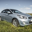Постер, плакат: Car Hyundai Accent in the sun