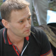 Постер, плакат: Opposition leader Alexei Navalny listens to speeches at the meeting of activists in Khimki forest