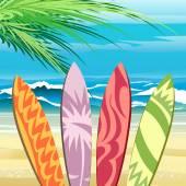 Four surf boards on a tropical beach against sea waves