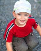 The little funny boy closeup portrait in good mood