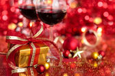 Gift and wine for holidays against blured lights.
