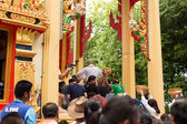 Unidentifield peoples ceremony new Ordained and throwing  money at Royong temple Thailand cultural