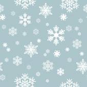 Seamless snowflake pattern on a blue background