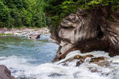 Wide mountain river with rapidly falling blur water. Waterfall p
