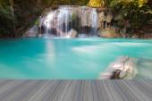Opening wooden floor, beautiful waterfall in deep forest national park