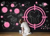 Lány rajz a táblára