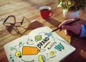 Podnikatel psaní v programu Poznámkový blok a koncept značky