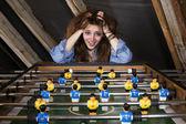 Dívka na stolní fotbal