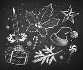 Chalked Christmas sketches collection drawn on black chalkboard background