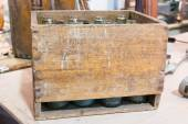 Empty bottles in vintage wodden crate
