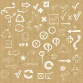 Check marks check boxes and arrows drawn in doodled style on brown kraft paper background