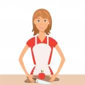 Illustrazione della donna graziosa sulla cucina. Vector