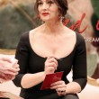 Постер, плакат: Monica Bellucci at the opening of the boutique of Dolce & Gabban