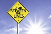 Read between the lines   road sign
