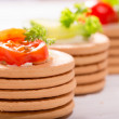 Постер, плакат: Vegetables on crackers: tomatoes cheese and greens