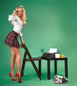 Secretary in a short skirt and stockings typing on a typewriter