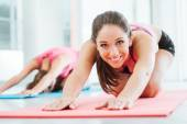 Girls doing stretching exercises