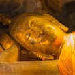 Постер, плакат: Smile Reclining Buddha statue nirvana position