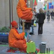 Постер, плакат: Street performers are showing a magical trick levitation in the air