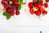 Cake with berries. Healthy sweets background.