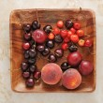Постер, плакат: Fruit platter peaches plums cherries on a wooden platter
