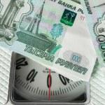 Постер, плакат: Rubble banknotes on the on the scales