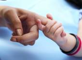 Mother and baby hands at home