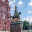 Постер, плакат: Bronze statue of Marshal Zhukov near the building of the Historical Museum