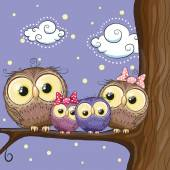 Four owls mother father son and daughter is sitting on a branch