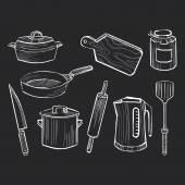 Hand drawn set of kitchen utensils on a chalkboard background