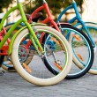 Постер, плакат: Three beautiful lady city bikes