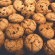 Постер, плакат: Lots of cookies and biscuits background