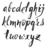 Hand drawn alphabet written with brush pen on white background