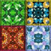Abstract kaleidoscopic background of stained glass mosaic windows for four seasons